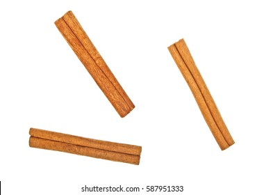Cinnamon sticks on white background, top view