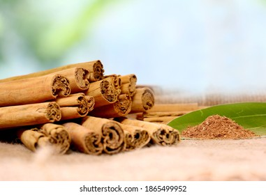 Cinnamon sticks and powder natural background