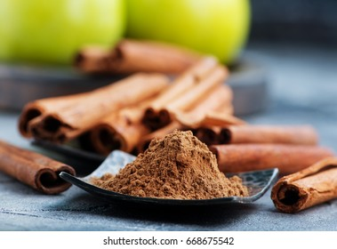 cinnamon sticks and powder on a table