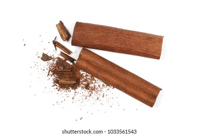 Cinnamon sticks with shavings isolated on white background, top view
