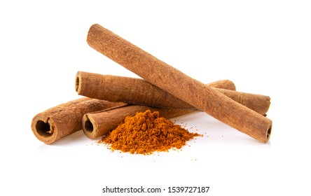 cinnamon sticks stacked and powder on white background