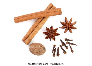 Cinnamon sticks with star anise, nutmeg and clove isolated on white background. Top view