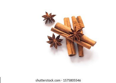 Cinnamon sticks and star anise on a white background