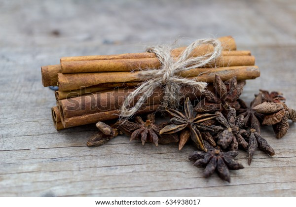 cinnamon sticks and star anise on wood background.