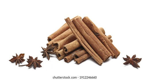 Cinnamon sticks and star anise pile isolated on white background