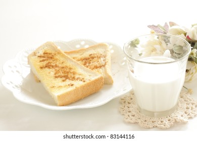 Cinnamon toast and milk for healthy breakfast