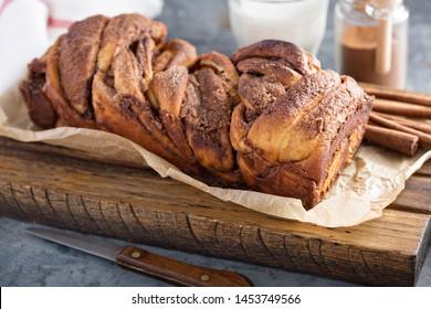 Cinnamon twisted loaf bread or babka on a cutting board