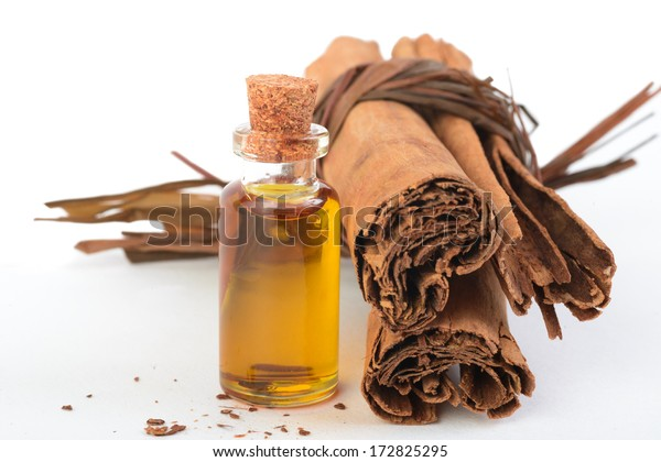Cinnamon in two stages: sticks and oil.