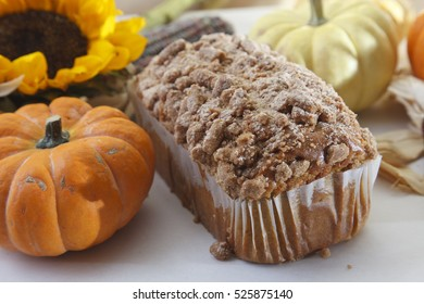 Cinnamon-topped pound cake surrounded by autumn themed elements
