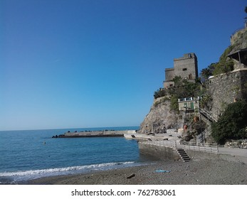 cinque terre, italy, view at ruins and harbour and coastline of mountain, mediterranean sea with blue sky