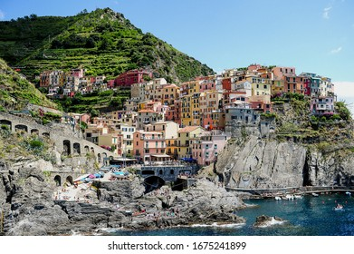 The Cinque Terre National Park surrounded by the sea under the sunlight in Italy