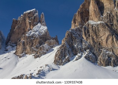 Cinquedita and Saassolungo during Winter. The Langkofel in the Dolomites covered in Snow. The Sasso lungo, Lang Kofel is just above Selva