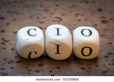 CIO (Chief Information Officer) text on wooden cubes on a brown cork background