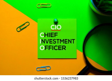 CIO. Chief Investment Officer acronym on sticky notes. Office desk background