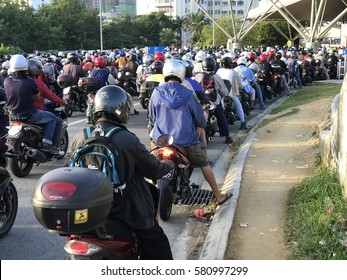 CIQ JOHOR BAHRU, MALAYSIA, 17 FEB 2017: Motorcycles stuck in the heavy traffic at Malaysia Checkpoint going in to Singapore.