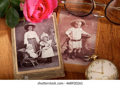 CIRCA 1915: Two antique family portraits of children.