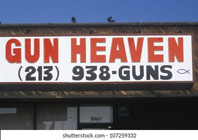 CIRCA 1989 - A sign that reads Gun Heaven