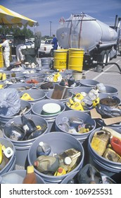 CIRCA 1990 - Containers of used oil and other toxic household chemicals awaiting further disposal at a Unocal station in Los Angeles, California