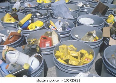 CIRCA 1990 - Various buckets of sorted recyclable materials