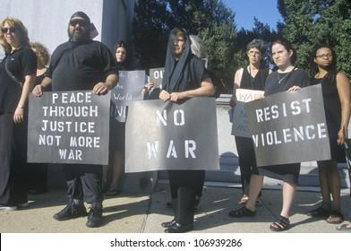 CIRCA 1991 - Anti-war protester in black marching at rally, Washington D.C.