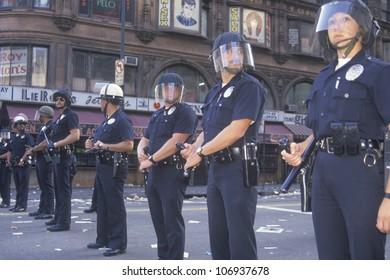 CIRCA 1992 - Police in riot gear, downtown Los Angeles, California