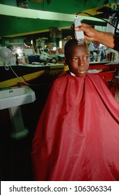 CIRCA 1993 - African American boy in barber's chair, Orlando, Florida