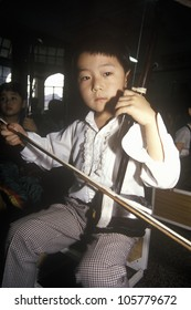 CIRCA 1994 - Music class at the Children's Palace of Changning District in Shanghai in Zhejiang Province, People's Republic of China