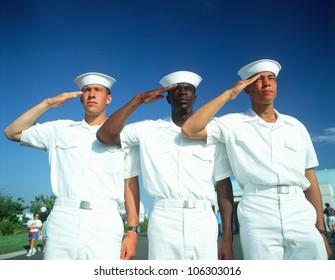 CIRCA 1998 - Ethnically diverse trio of sailors saluting