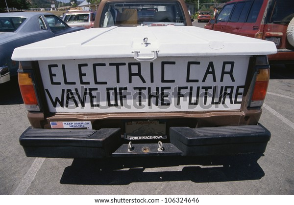 CIRCA 1999 - Tailgate of pickup truck with banner, Electric Car, Wave of the Future