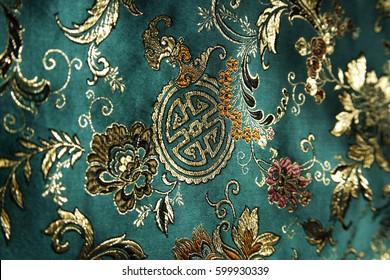 CIRCA 2007: Detail of jade green Chinese silk fabric