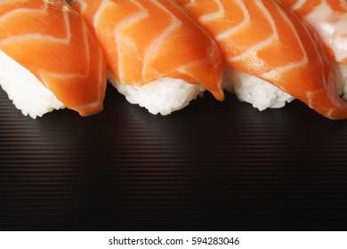CIRCA 2007: Four pieces of Salmon Sushi, nigiri on rice ball