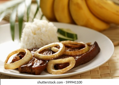 CIRCA 2011: Pork steak with rice (Bistik Tagalog). Traditional Filipino dish