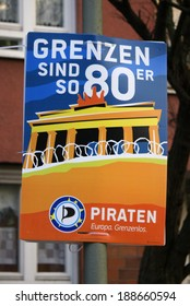 """CIRCA APRIL 2014 - BERLIN: an election poster to the upcoming european elections from the """"Piratenpartei"""" (pirate party) with the slogan """"Grenzen sind so 80er"""" (borders are so 80s), Berlin."""