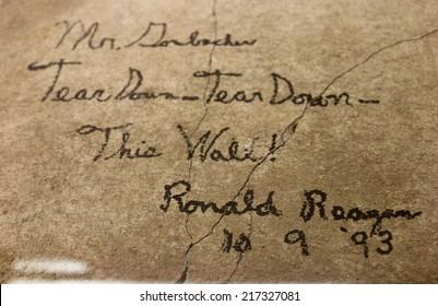 "CIRCA AUGUSTv 2014 - BERLIN: historical handwriting of the former US president Ronald Reagan: ""Mr Gorbachev - Tear Down This Wall!"", Kulturkaufhaus Dussmann, Berlin-Mitte"