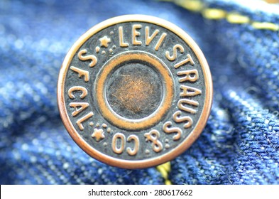 CIRCA JUNE 2014   KWIDZYN: Closeup of Levi Strauss button on blue jeans. Levi Strauss & Co. is American clothing company known worldwide for its Levis brand of denim jeans. It was founded in 1853.