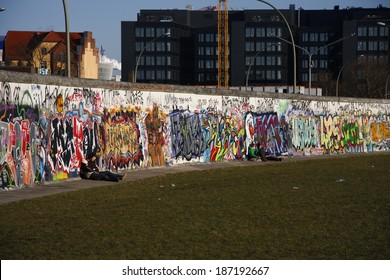 "CIRCA MARCH 2013 - BERLIN: graffities on remnants of the Berlin Wall at the ""East Side Gallery"" in the Friedrichshain district of Berlin."