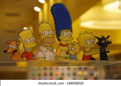 CIRCA MARCH 2014 - BERLIN: the characters of the Simpson comic tv series: Homer, Maggie, Lisa, Marge and Bart Simpson.