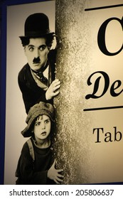 CIRCA MAY 2014 - BERLIN: an film scene with Charlie Chaplin as part of the logo of a kisosk in the Prenzlauer Berg district of Berlin.