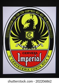 """CIRCA MAY 2014 - BERLIN: the logo of the brand """"Cerveza Imperial""""."""