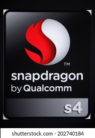 """CIRCA MAY 2014 - BERLIN: the logo of the brand """"Snapdragon by Qualcomm""""."""