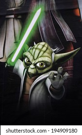 "CIRCA MAY 2014 - BERLIN: a poster with the comic ""Yoda"" character as an advertisement for the upcoming movie ""Clone Wars"", ""Star Wars"", Berlin."