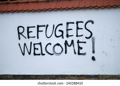 """CIRCA NOVEMBER 2014 - BERLIN: Graffity with the political slogan """"Refugees Welcome"""", Berlin."""