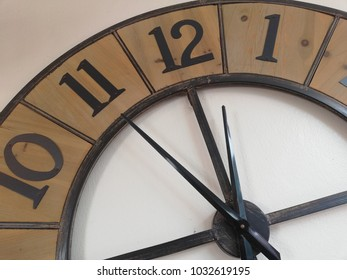 The circle clock was decorate on the white wall. The loft style of clock on the white background.