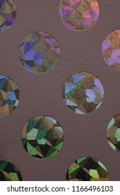 circle color hologram grafic elemente on paper texture