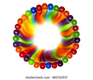 Circle of colored glazed candies isolated on white background. candies melting in several rows, forming a rainbow frame