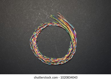 A circle of colored threads.