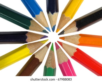 Circle of colorful crayons isolated over white background