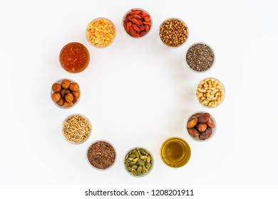 a circle of different types of superfoods, nutrient concept illustration on white
