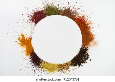 Circle frame composition of spices and herbs isolated on white background with copy space. Frame of Indian spices and herbs. Ingredients of asian cuisine spices