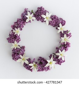 Circle frame, wreath of purple flowers on a white background, greeting card, decoration postcard or invitation